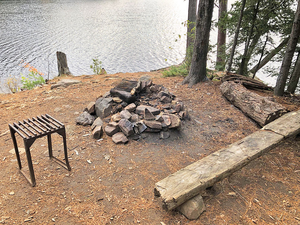 Fire pit and seating area on Ragged Lake campsite #9