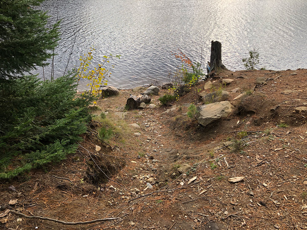 Incline from the canoe landing to the main campsite area on Ragged Lake campsite #9