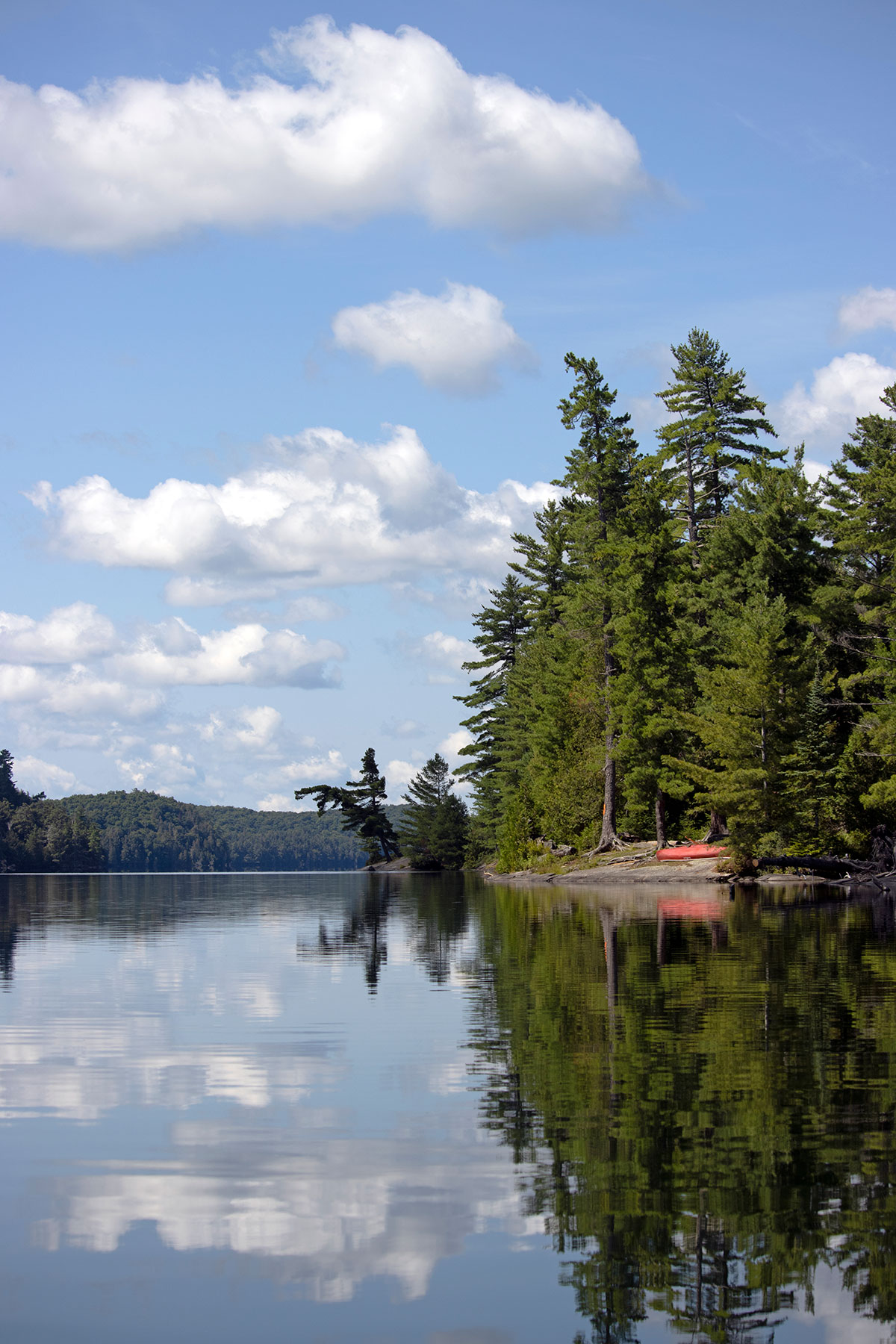 Campsite with red canoe on Ralph Bice Lake in Algonquin Park