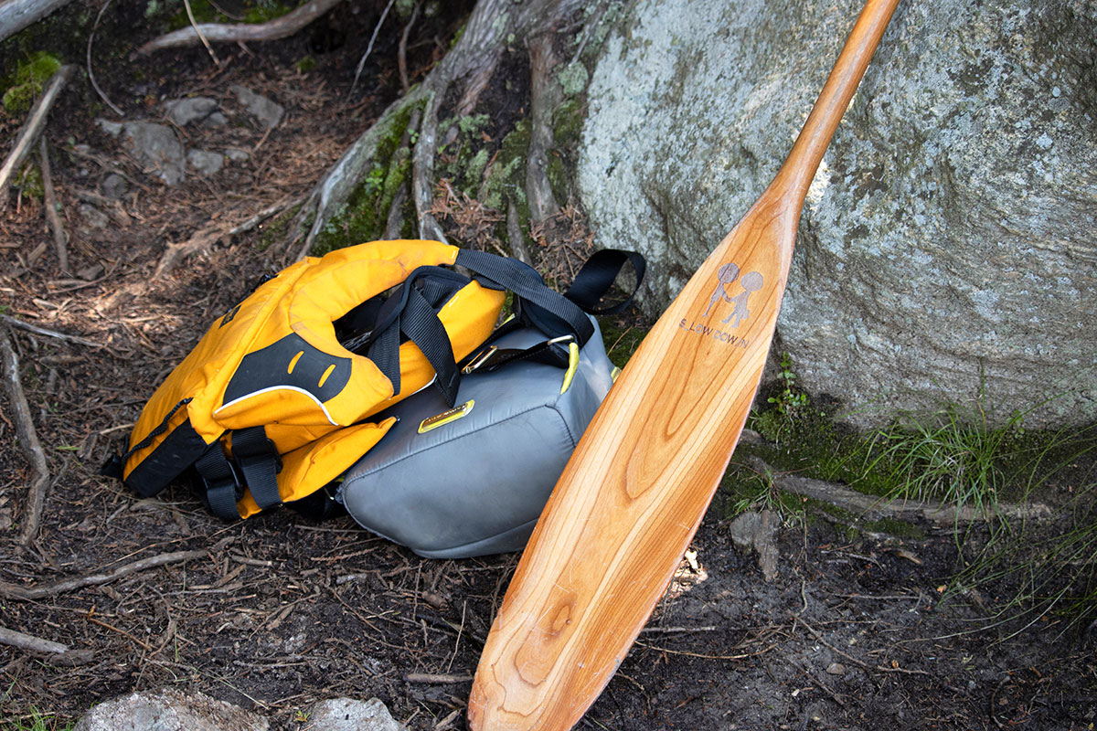 Canoe paddle, PFD and backpack at portage landing in Algonquin Park
