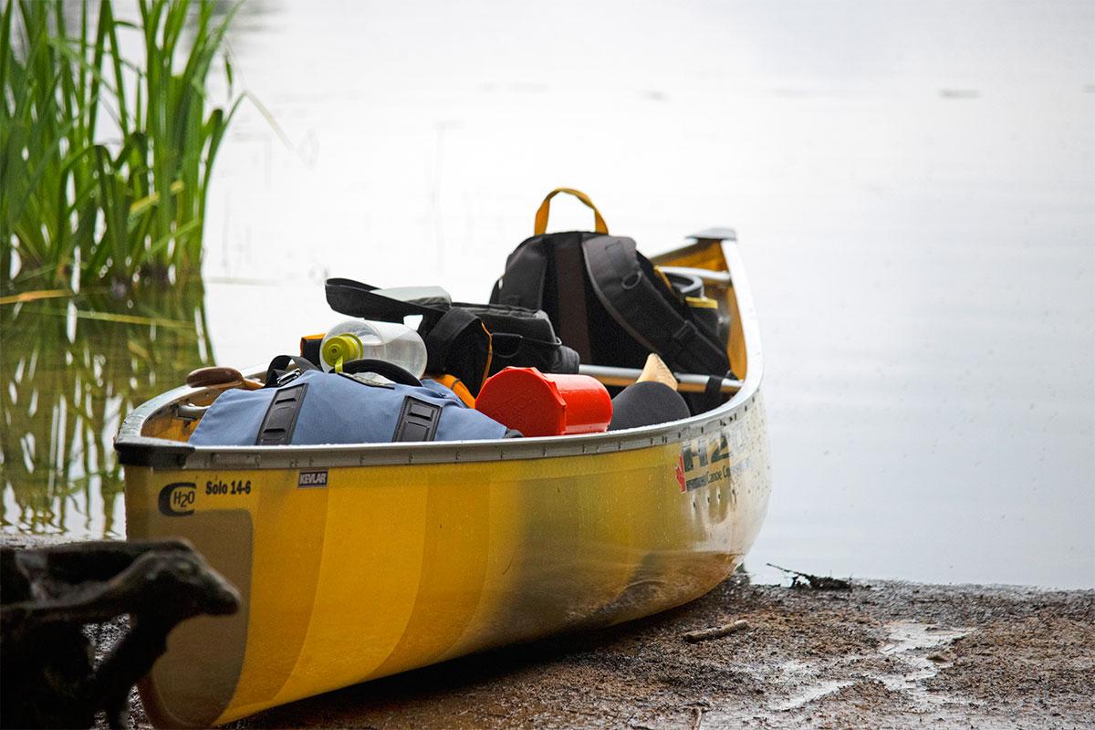 Solo canoe fully loaded on Hambone Lake ready to paddle