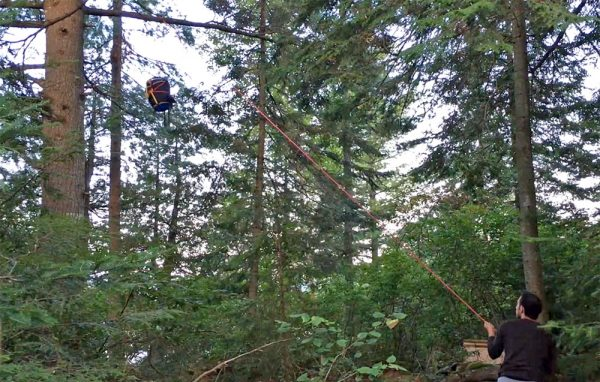 Hoisting a food pack in the interior of Algonquin Park